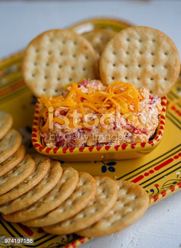 homemade pimento cheese dip, made with shredded cheddar cheese, mayonnaise, pimentos and red pepper flakes with crackers