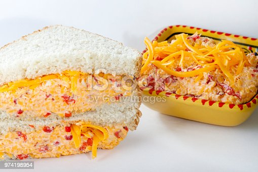 homemade pimento cheese sandwiches, made with shredded cheddar cheese, mayonnaise, pimentos and red pepper flakes.