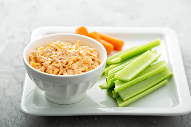 Pimento cheese with celery and carrot stock photo