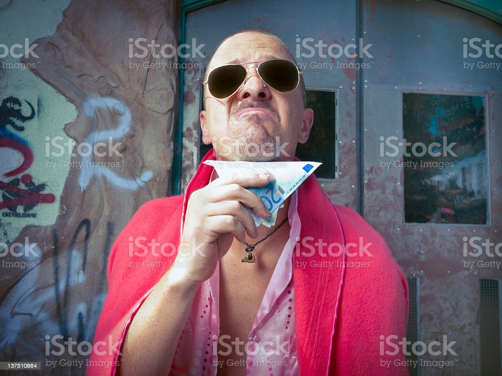Pimp in the slums stock photo