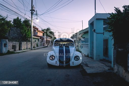 istock Pimped old beetle volkswagen car in the streets of Valladolid during sunset, Yucatan, Mexico 1281344067