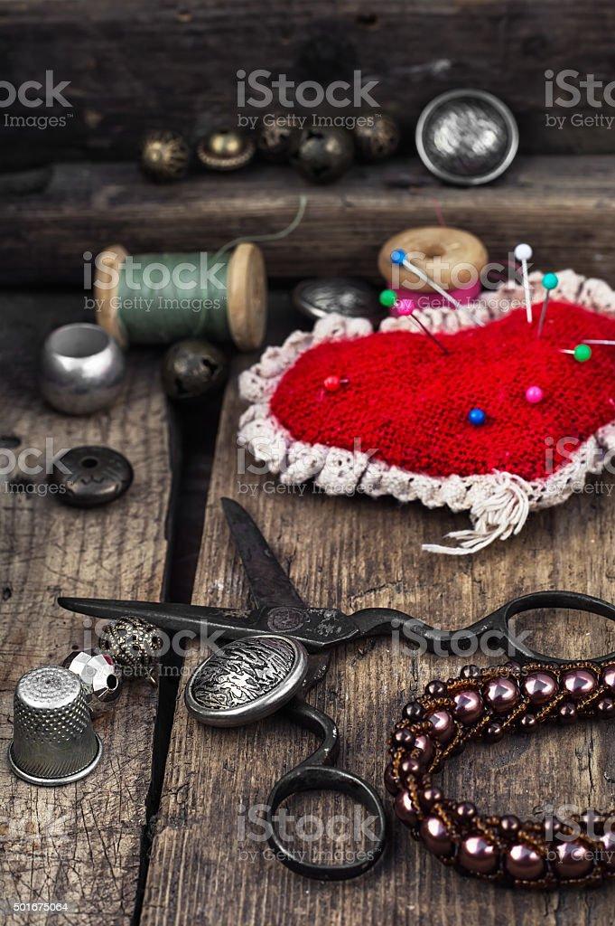 pin cushion and sewing tools stock photo