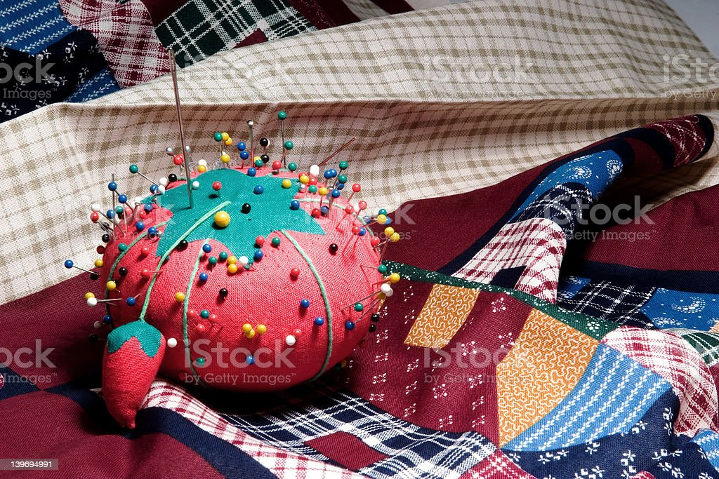 Pin Cushion on Fabric stock photo