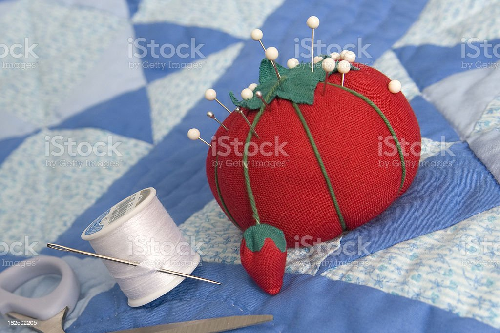 Pin cushion, tread and quilt stock photo
