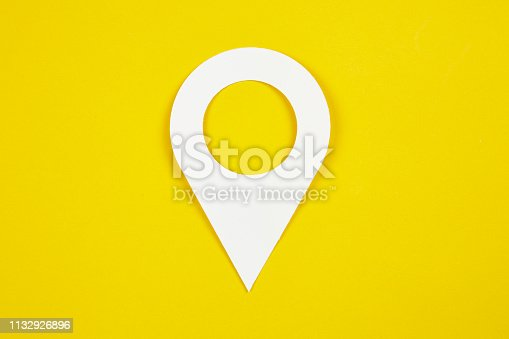 Pin icon on yellow background