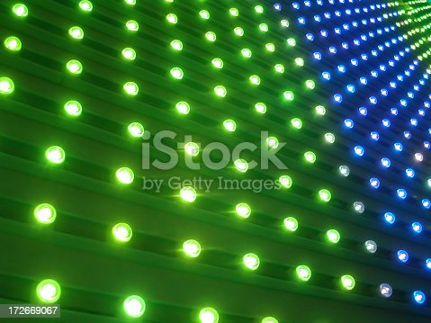 perspective view of a wall of blue and green pin lights