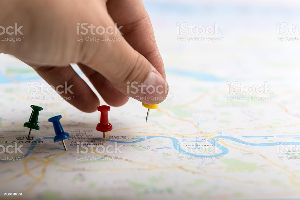 Pin marking location on map stock photo