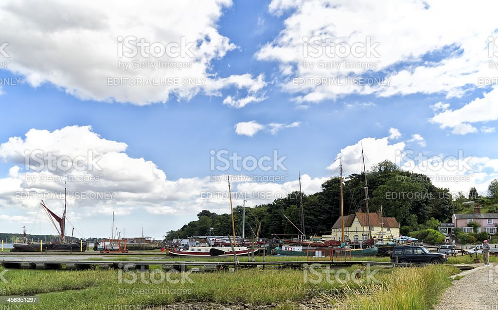 Pin Mill, Suffolk, with boats in the mud stock photo