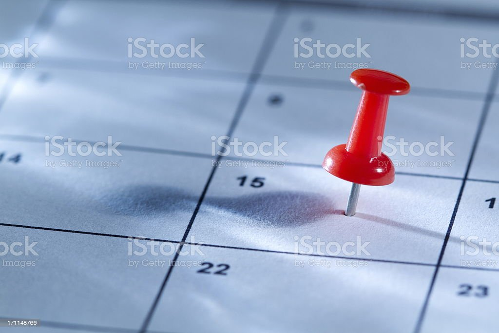Pin on calendar stock photo