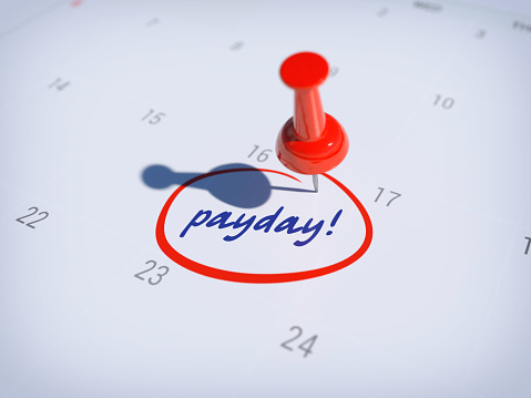istock Pin on calendar with words PAYDAY 1132423450