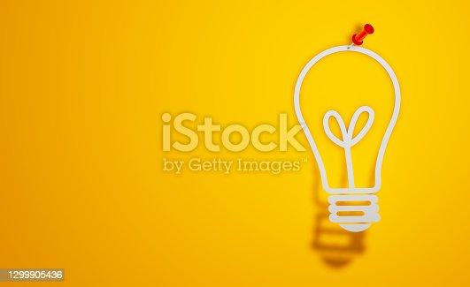 Pin Paper Light Bulb Symbol on Yellow Background