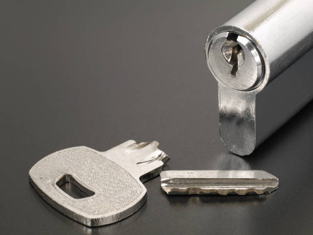 Pin tumbler of cylinder lock internal mechanism and broken key with copy space stock photo