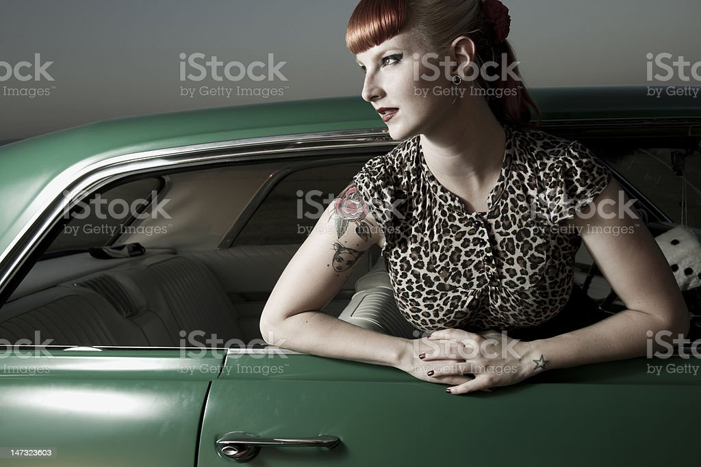 pin up girl in a car stock photo