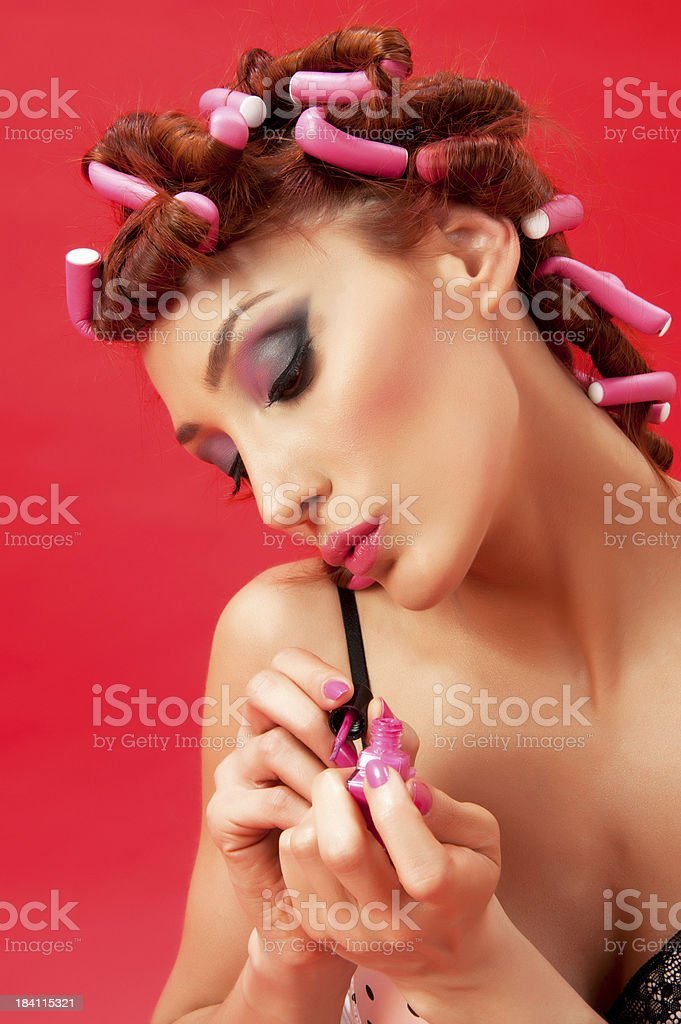 Pin Up Girl Painting Her Nails royalty-free stock photo