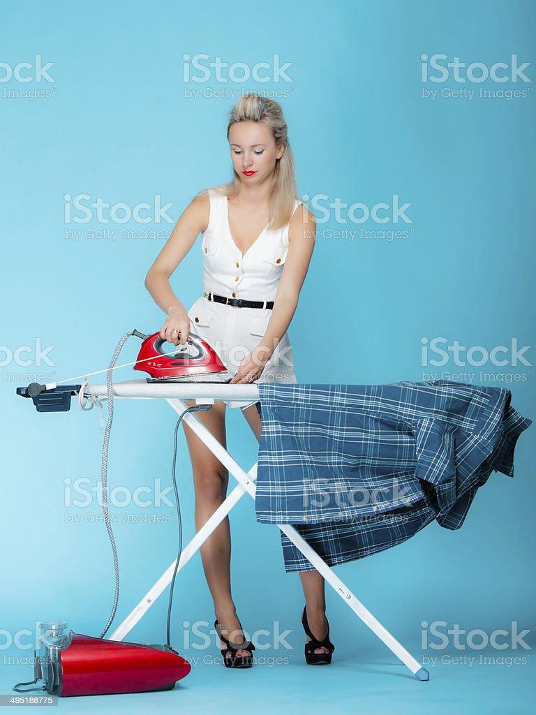 pin up girl retro style portrait woman ironing stock photo