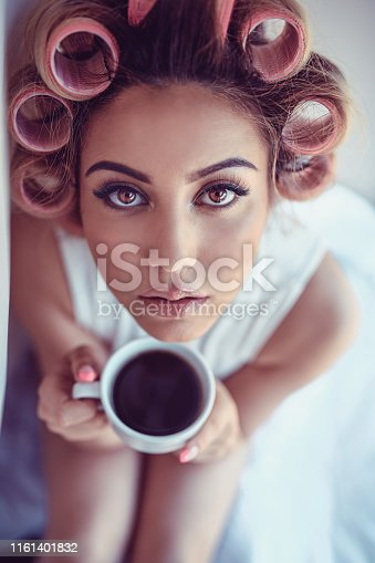 Pin Up Girl With Hair Curlers Drinking Coffee