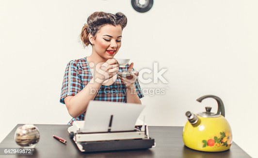 471445335istockphoto Pin Up girl with typewriter 642949872
