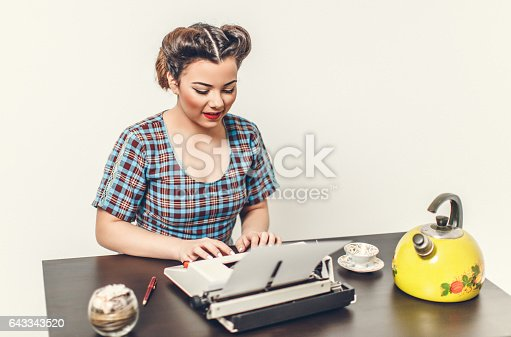 471445335istockphoto Pin Up girl with typewriter 643343520