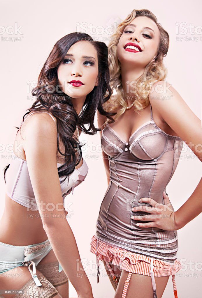 Pin Up girls in pink stock photo