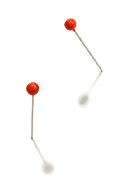 pin with red head pins with red head on a white background straight pin stock pictures, royalty-free photos & images