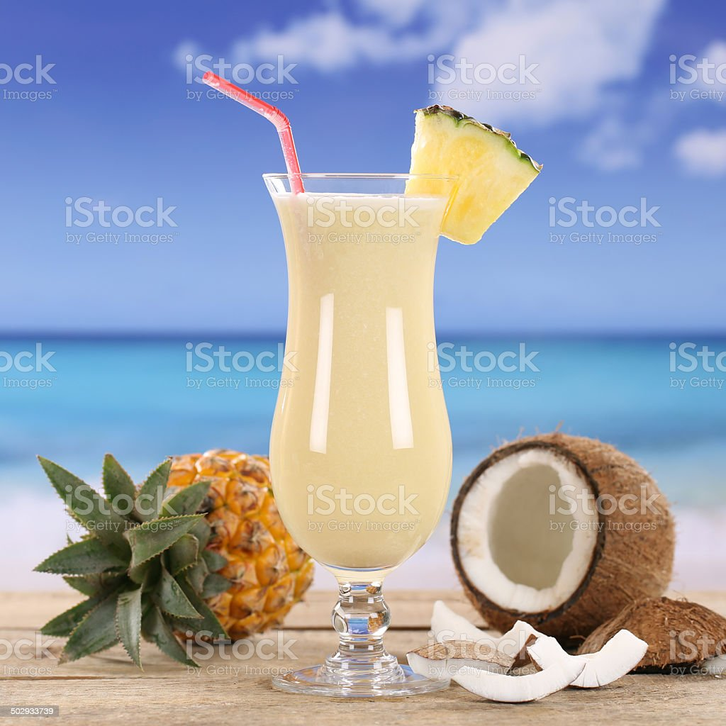 Pina Colada cocktail drink on the beach stock photo