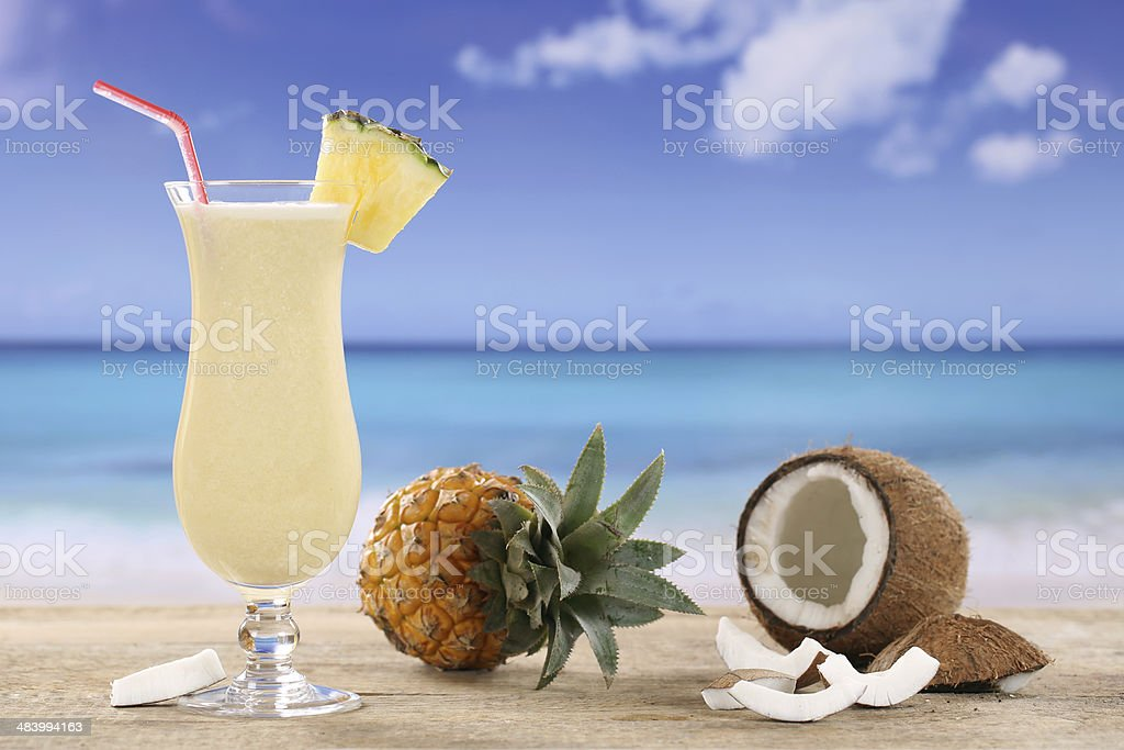 Pina Colada cocktail on the beach stock photo