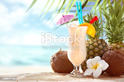 istock Pina Colada cocktail on the beach with copy space 169947794
