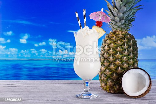 Classic Pina colada cocktail on sea background