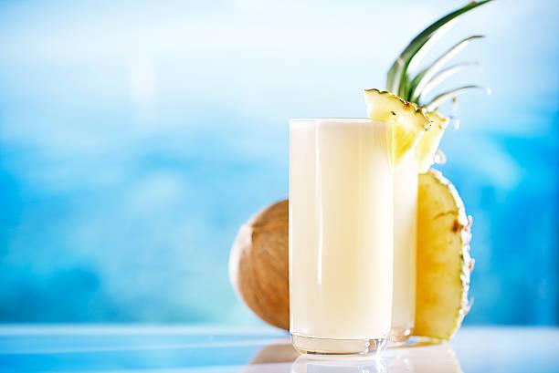 pinacolada pina colada cocktail on beach stock photo