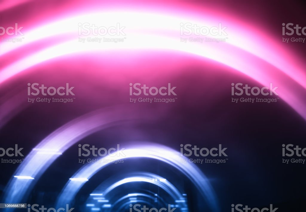 Pinak and blue curved motion blur arc background stock photo
