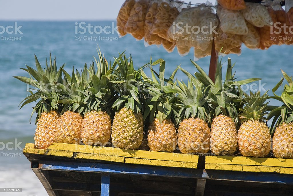 Pinapples for sale on tropical beach royalty-free stock photo