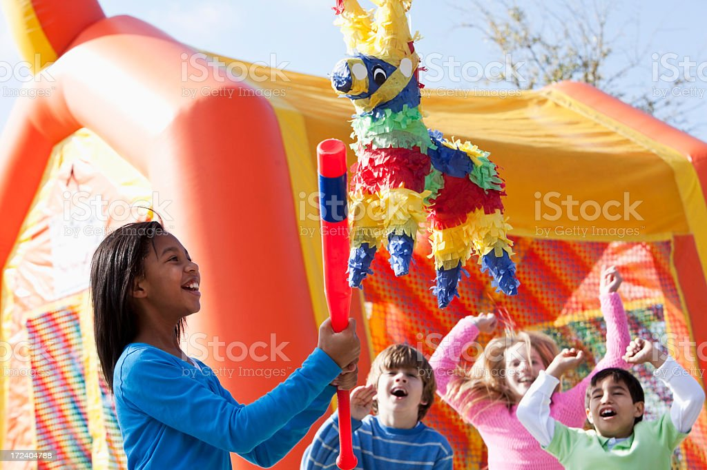 Pinata at children's birthday party stock photo