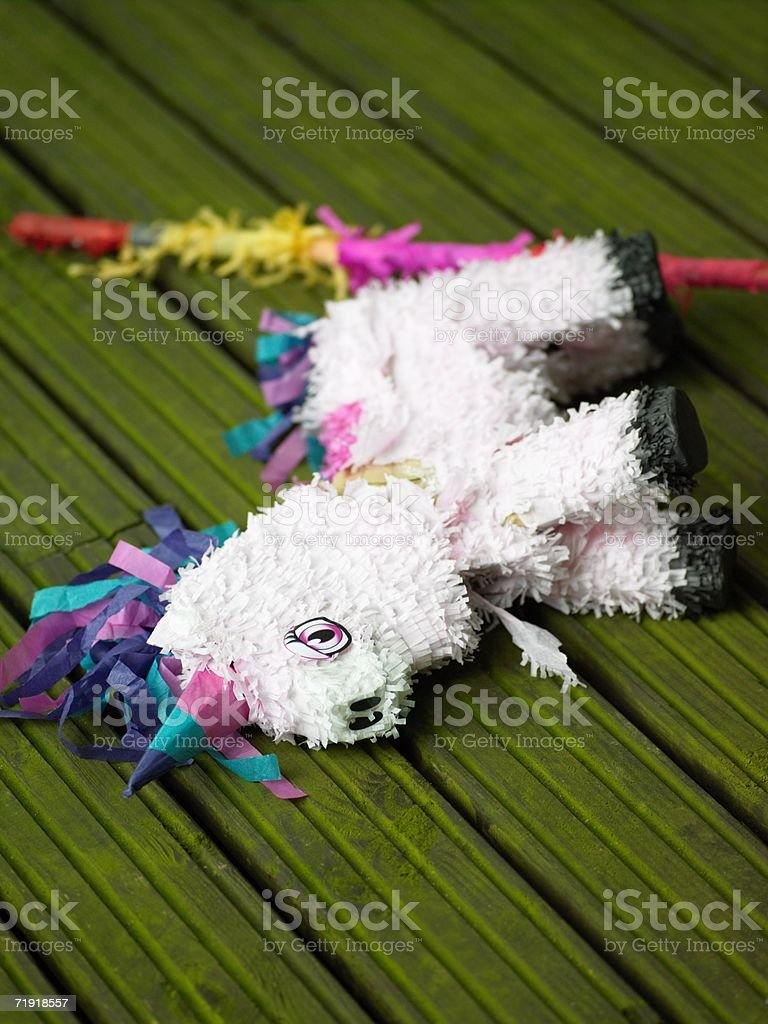 Pinata lying on decking royalty-free stock photo