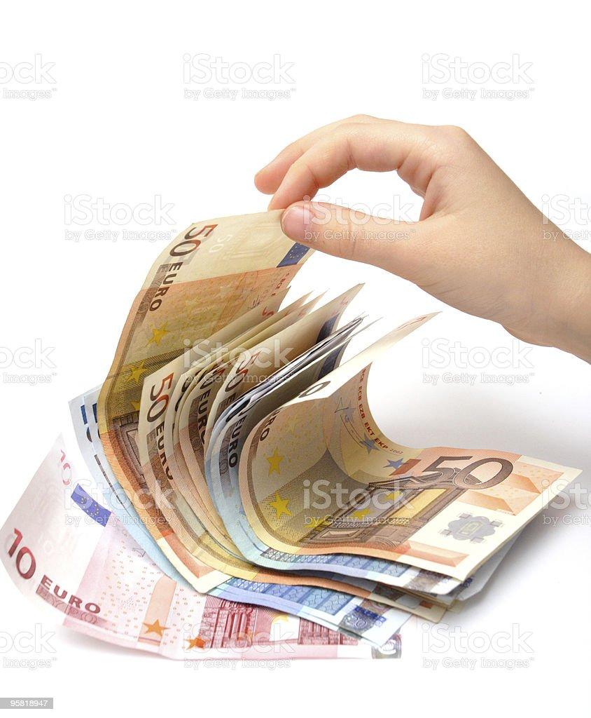 pinching a money royalty-free stock photo