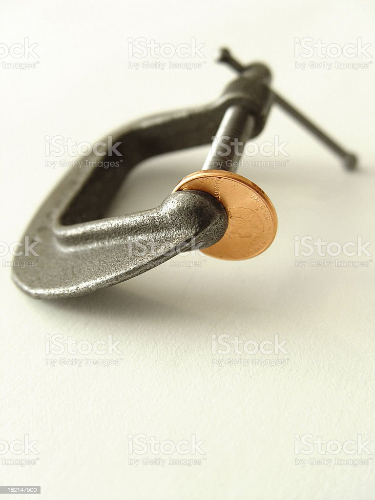 Pinching a penny stock photo