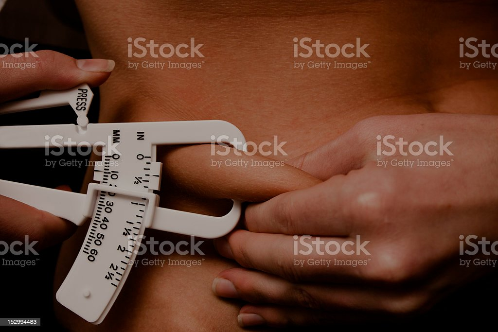 Pinching abdomen fat stock photo