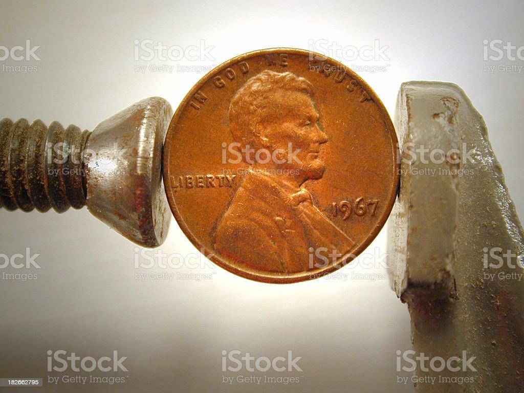 Pinching Pennies royalty-free stock photo