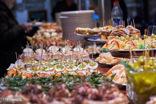 istock Pinchos and tapas typical of the Basque Country, Spain. Selection of different types of foods to choose from. San Sebastian 1137594933