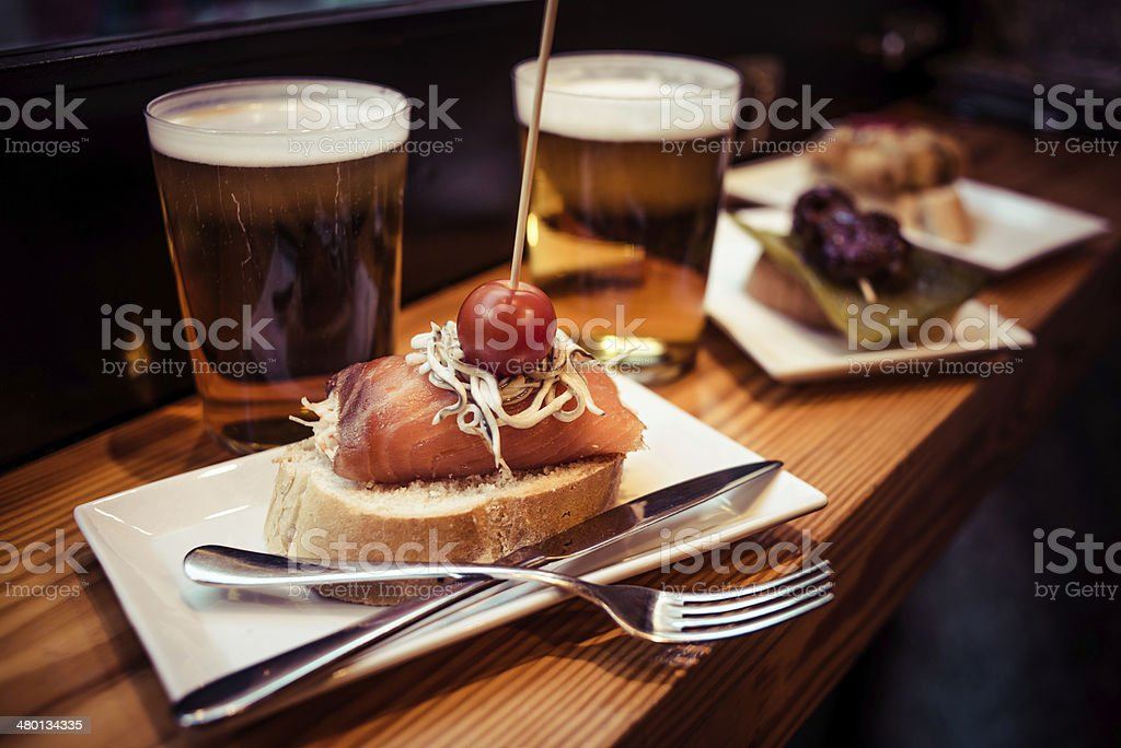 Pinchos from the Basque country served with beer stock photo