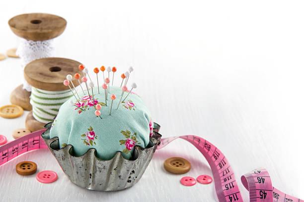 Pincushion in an antique  metal cupcake stock photo