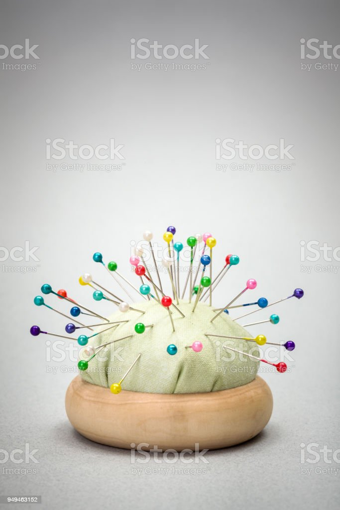 Pincushion With Colorful Pins Stock Photo - Download Image
