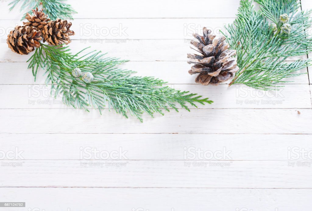 pine and cypress cones with twigs on white wood table