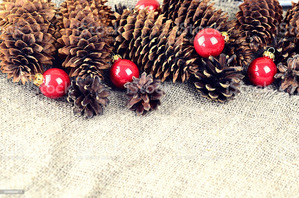 Pine and spruce cones and red christmas balls stock photo