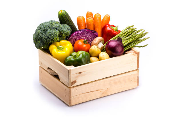 pine box full of colorful fresh vegetables on a white background - group of people стоковые фото и изображения