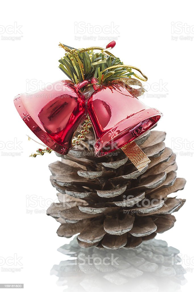 Pine cone and glass bell royalty-free stock photo