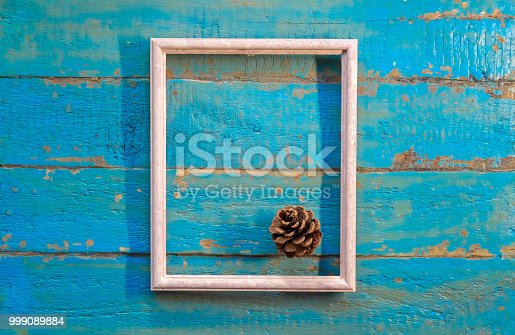 istock pine cone lies in a white empty frame 999089884