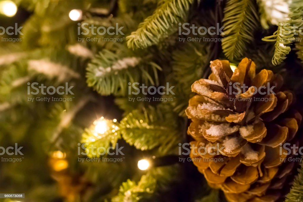 pine cone snow festive decoration christmas glowing garland close-up, base greeting card merry christmas and new year stock photo
