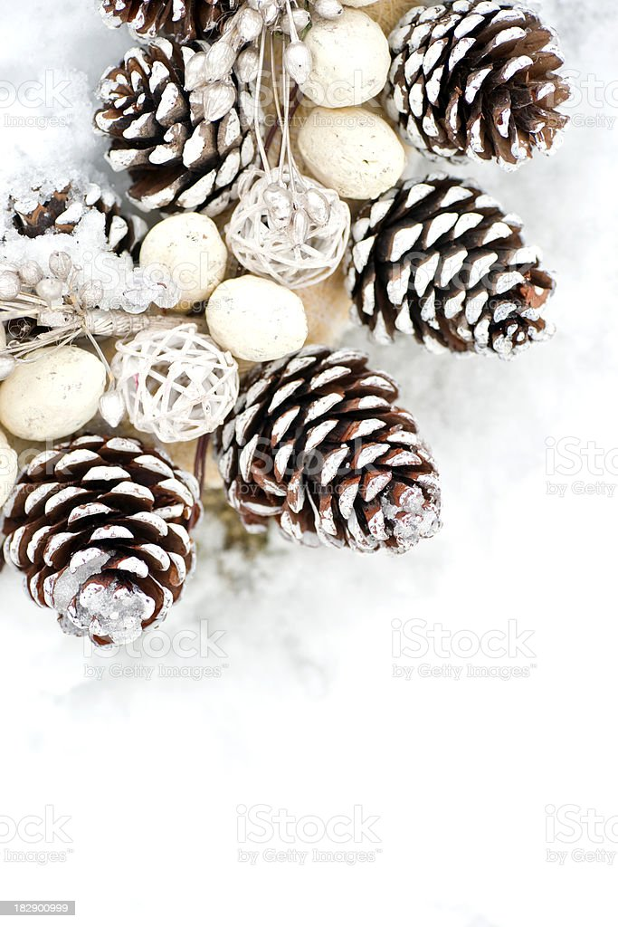 Pine cone wreath on snow covered wall royalty-free stock photo