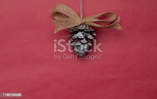 Pine cones Christmas decoration on red background