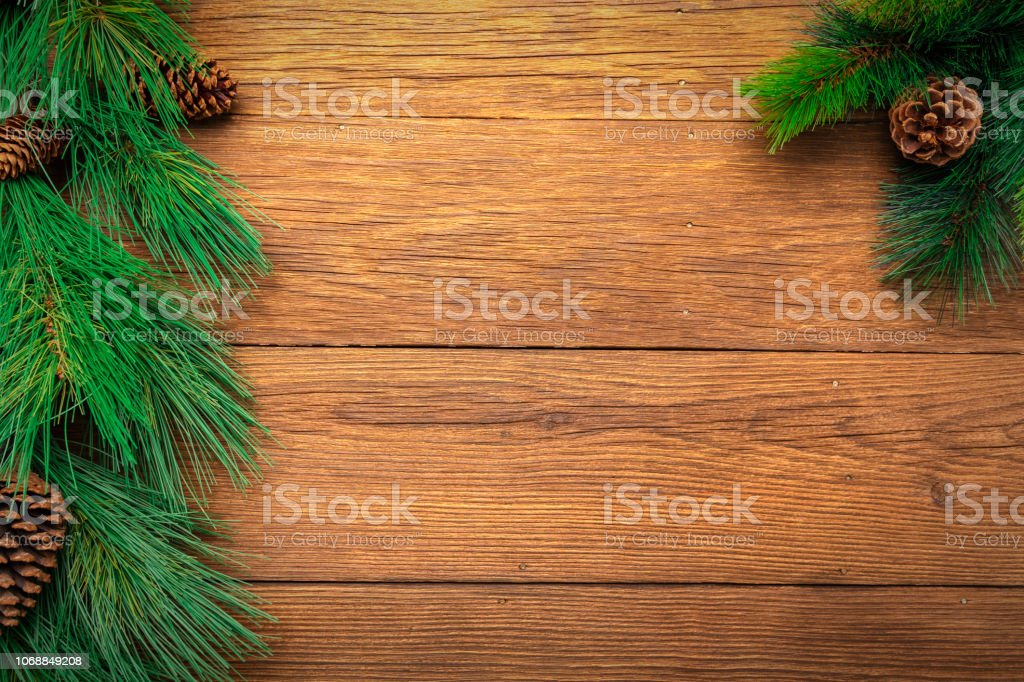 Long needle pine garland branches with pine cones sitting on old worn...